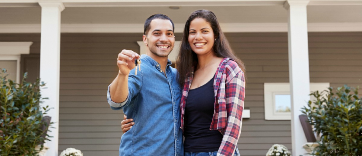 Happy Couple with House Keys