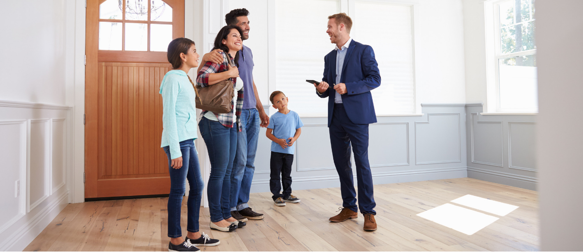 Realtor talking to family in unfurnished home